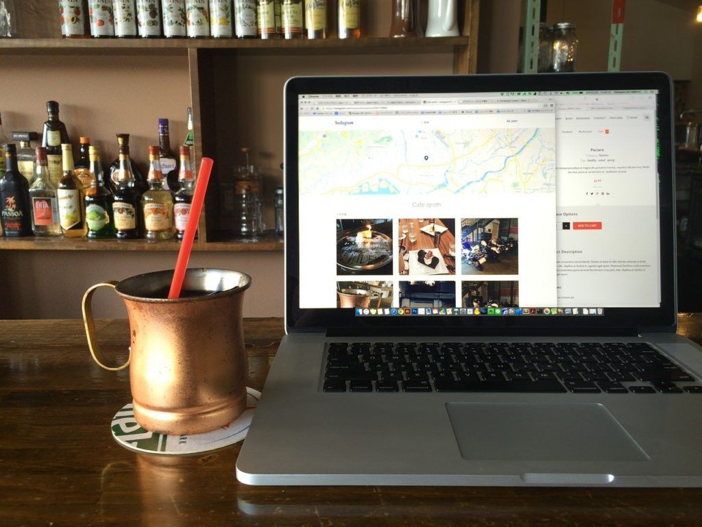 a laptop on a table in a bar